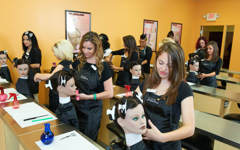 student with beauty practical exam on manniquenn head