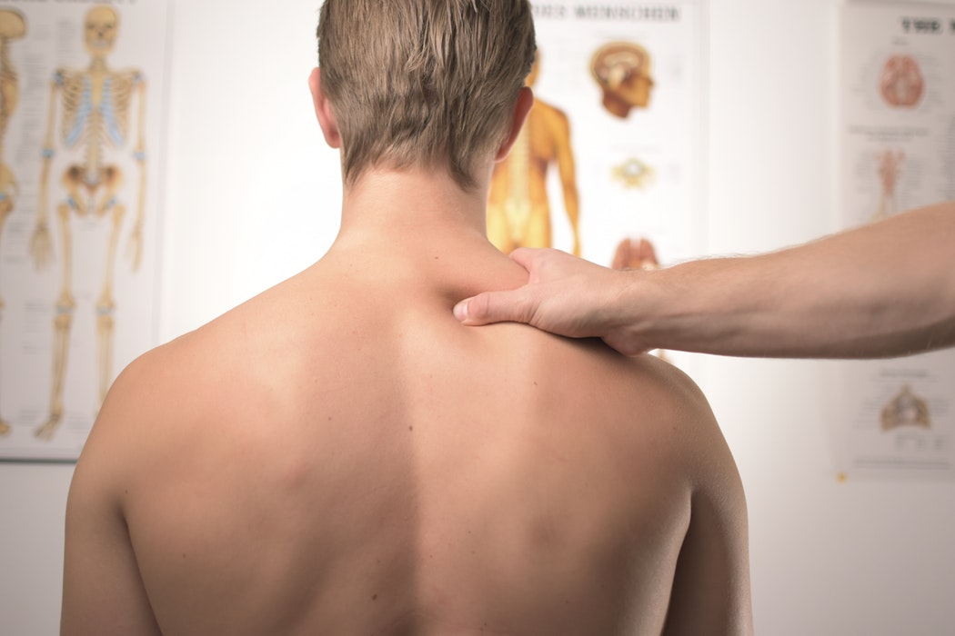 massaging man`s back